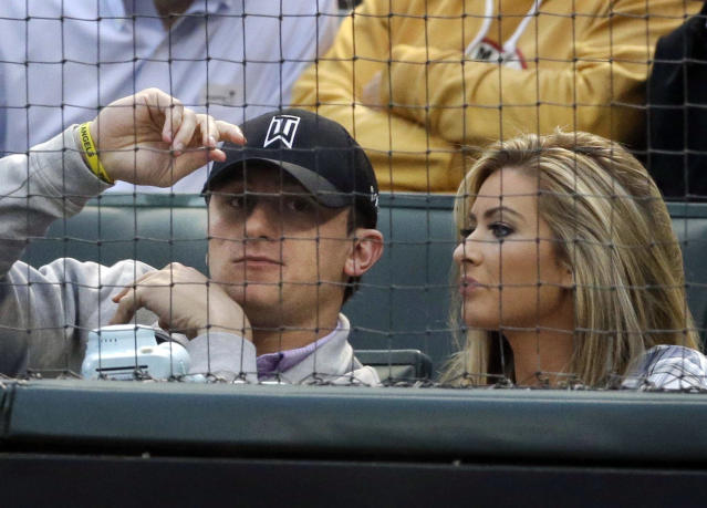 In this 2015 file photo, Manziel sits with Colleen Crowley during a baseball game between the Angels and Rangers. Prosecutors in Dallas dismissed a 2016 misdemeanor domestic assault charge against Manziel, who successfully completed requirements of a court agreement that included taking an anger management course and participating in the NFL's substance-abuse program. Manziel also had to stay away from Crowley, who accused him of hitting and threatening her during a January 2016 night out. (AP)