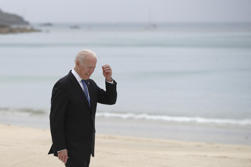 US President Joe Biden walks along the boardwalk during the G7 summit in Carbis Bay, Cornwall, south-west England on June 11, 2021. (Photo by PHIL NOBLE / POOL / AFP) (Photo by PHIL NOBLE/POOL/AFP via Getty Images)