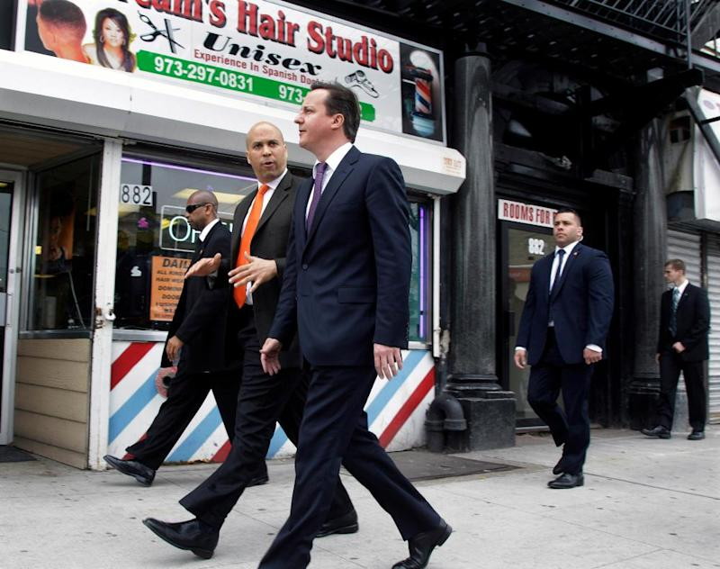 Cory Booker walks through downtown Newark with David Cameron, then British prime minister, in March 2012.
