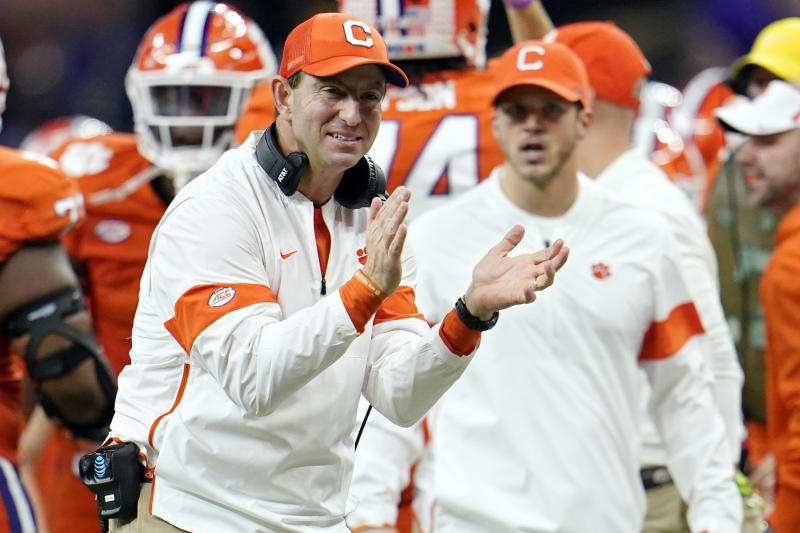 FILE - In this Jan. 13, 2020, file photo, Clemson head coach Dabo Swinney celebrates after his team scored during the second half of a NCAA College Football Playoff national championship game against LSU in New Orleans. The Tigers have locked up the best recruiting class of the Dabo Swinney era, which already includes two national titles and five playoff appearances. (AP Photo/David J. Phillip, File)