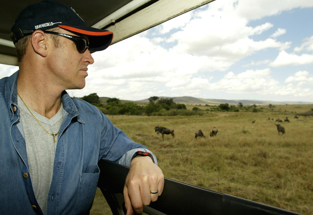 NAIROBI - SEPTEMBER 2:  Matthew Hayden of Australia takes in the wildlife during a safari to the Masai Mara, Kenya on September 2, 2002. (Photo by Hamish Blair/Getty Images)