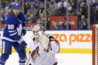 Arizona Coyotes goaltender Adin Hill (31) defects the puck just over his net as Toronto Maple Leafs right wing William Nylander (88) looks on during second period NHL hockey action in Toronto on Tuesday Feb. 11, 2020. (Nathan Denette/The Canadian Press via AP)