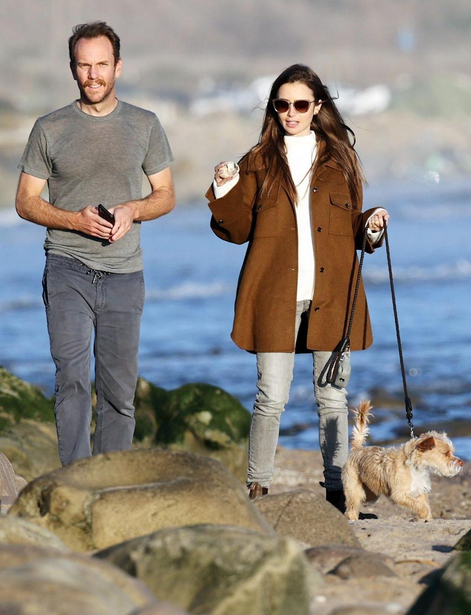 <p>Newly engaged couple Lily Collins and Charlie McDowell's new relationship is rock solid as they take their pup for a walk in Carpinteria, California on Monday. </p>