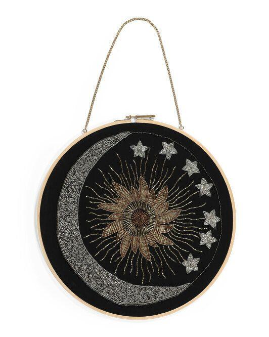 "The metallic beads make this wall hanging especially magical and mystical. <a href=""https://fave.co/3o5NRdl"" target=""_blank"" rel=""noopener noreferrer"">Find it for $17 at T.J.Maxx</a>."