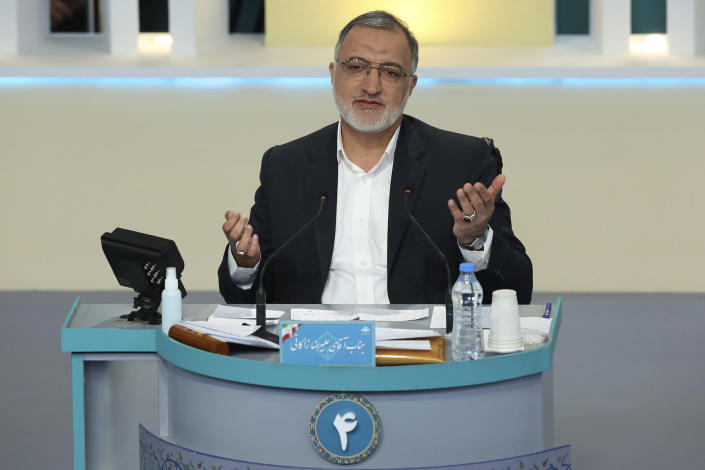 In this photo made available by the government-affiliated Young Journalists Club, presidential candidate Alireza Zakani speaks in a televised debate in a state-run television studio, in Tehran, Iran, on Saturday, June 5, 2021. Elections are scheduled for June 18. (Morteza Fakhri Nezhad/YJC via AP)