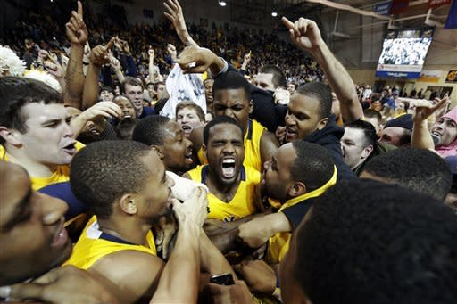 La Salle's Ramon Galloway, center, is mobbed by teammates and fans after La Salle won an NCAA college basketball game against Butler, Wednesday, Jan. 23, 2013, in Philadelphia. La Salle won 54-53. (AP Photo/Matt Slocum)