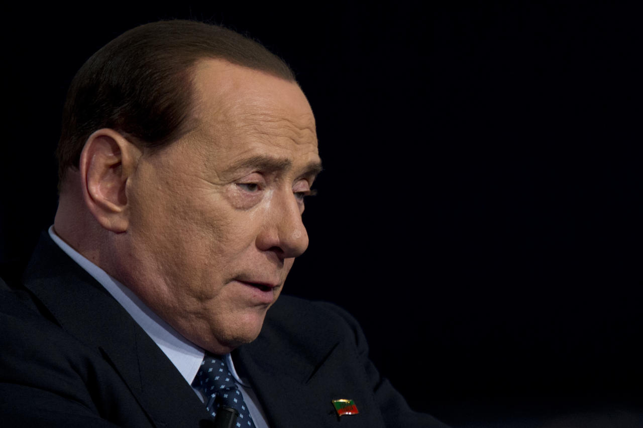 FILE -- In this file photo taken in Rome on May 21, 2014, former Italian Premier and Forza Italia (Go Italy) party leader Silvio Berlusconi talks during the recording of a tv-talk show. An Italian court on Friday was considering its decision on former Premier Silvio Berlusconi's appeal against a sex-for-hire case that revealed details of raunchy, sex-fueled bunga-bunga parties at his private villa attended by a bevy of aspiring showgirls. Berlusconi was sentenced to seven years in jail and handed a lifetime political ban after being convicted last year of paying for sex with an underage prostitute and then using his influence to cover it up. He denies the charges. (AP Photo/Andrew Medichini)