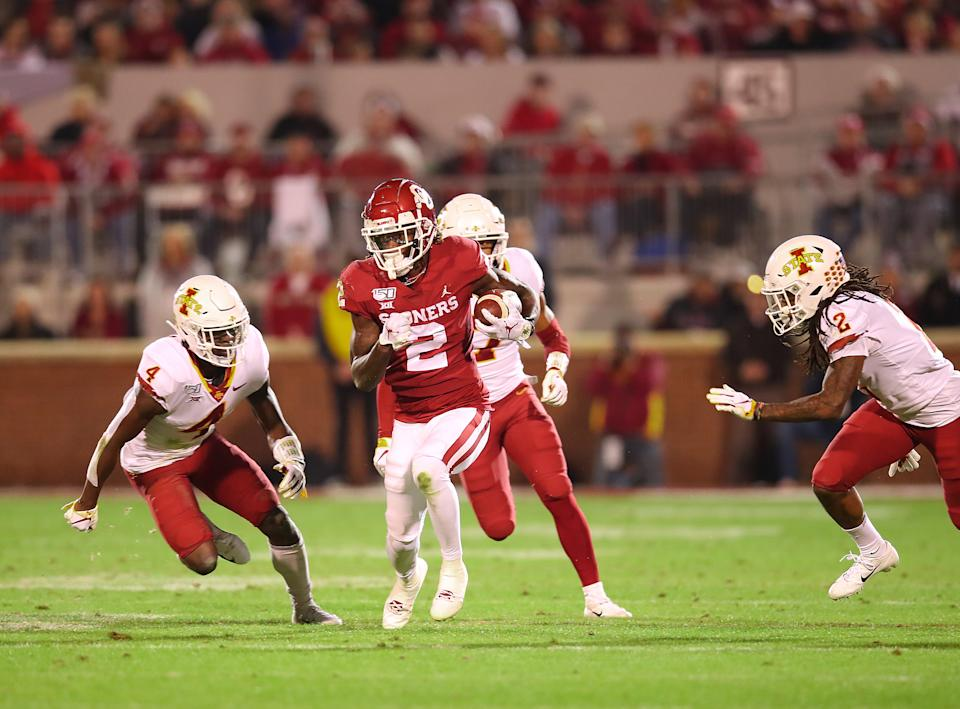 NORMAN, OK - NOVEMBER 09: Oklahoma Sooners WR Ceedee Lamb  (2) out runs the defenders for a big gain during a college football game between the Oklahoma Sooners and the Iowa State Cyclones on November 9, 2019, at Memorial Stadium in Norman, OK.  (Photo by David Stacy/Icon Sportswire via Getty Images)