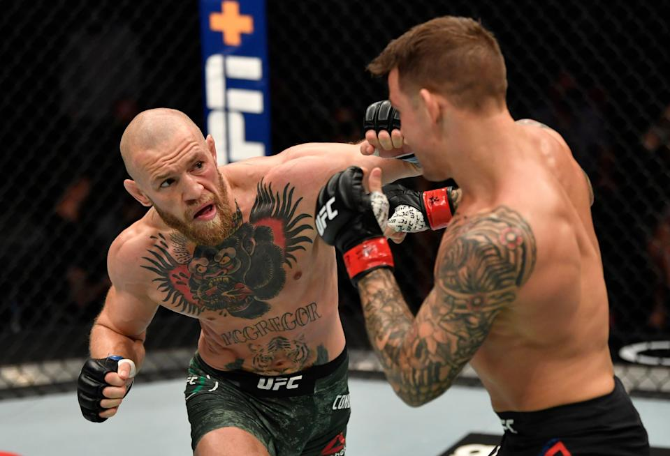 <p>Conor McGregor and Dustin Poirier during their UFC 257 clash</p> (Zuffa LLC via Getty Images)
