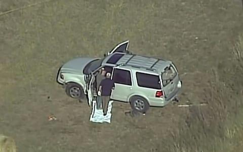 <span>Local TV images as police look at the alleged gunman's car </span>