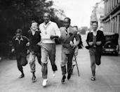 """<p>Owens was a track-and-field athlete who <a href=""""http://time.com/3971065/photos-1936-summer-olympics-jesse-owens/"""" rel=""""nofollow noopener"""" target=""""_blank"""" data-ylk=""""slk:set a world record"""" class=""""link rapid-noclick-resp"""">set a world record</a> in the long jump at the 1936 Olympic Games in Berlin—and went unrivaled for 25 years. He won four gold medals at the Olympics that year in the 100- and 200-meter dashes, along with the 100-meter relay and other events off the track. In 1976, Owens received the Presidential Medal of Freedom and was posthumously awarded the Congressional Gold Medal in 1990.</p>"""