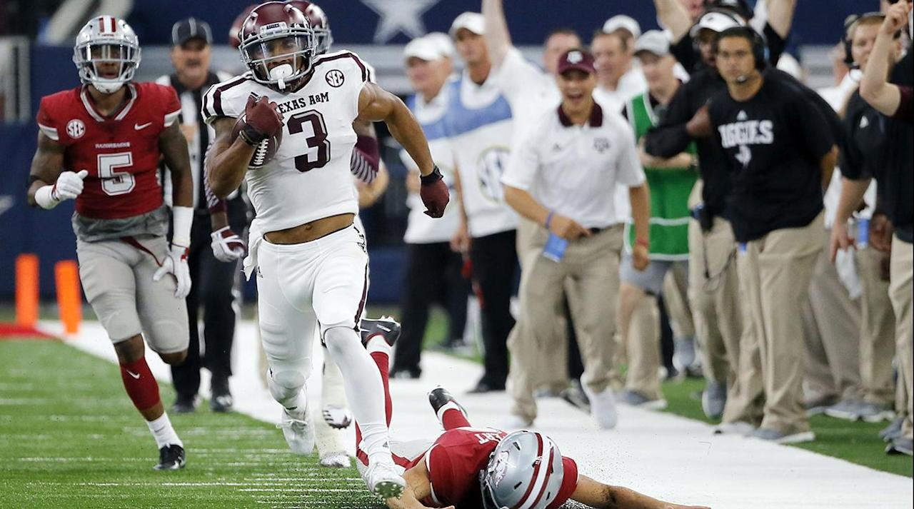 <p>By the time Arkansas and Texas A&M met on Saturday, both programs had squandered most, if not all of, the preseason optimism about their on-field prospects. The Aggies had coughed up a 34-point lead to fall to UCLA in Week 1, while the Razorbacks were hammered at home by TCU in Week 2. Neither team seemed likely to rebound to mount a challenge to Alabama in the SEC West or factor into the College Football Playoff race, but that didn't mean there wasn't a lot riding on the Southwest Classic at AT&T Stadium.</p><p>Progress was demanded of both head coaches this season, and both had failed in that regard so far. Kevin Sumlin will leave North Texas with his seat cooled, at least temporarily, after the Aggies fought back from a 14-point first-half deficit and overcame an egregious referee error to edge the Razorbacks, 50–43, in overtime, improving to 3–1 as they prepare to enter the meat of their SEC slate.</p><p>Whether because of flagrantly poor defense, brilliant offense or a combination of the two, this game evolved from a taut, two-way battle between evenly matched foes into a fast-paced shootout where only one side of the ball seemed to matter. Between the 11:40 and 3:39 marks of the fourth quarter, the Razorbacks and Aggies combined for four touchdowns on consecutive drives. Texas A&M failed to keep the streak alive on its last series of regulation, as a 27-yard field goal from junior Daniel LaCamera sent the game to overtime.</p><p>That's when Christian Kirk, in what must have felt like a recurring nightmare for Arkansas, ended the drama. The scintillating junior, who had scored on an 81-yard touchdown catch and a 100-yard kick return in regulation, sprinted to the goal line, shedded his defender with a sharp left turn and brought in a strike from freshman quarterback Kellen Mond at the left edge of the end zone for a 10-yard touchdown. Arkansas's attempt to send the game to a second extra session ended when Aggies senior defensive back Armani Watts snatched a