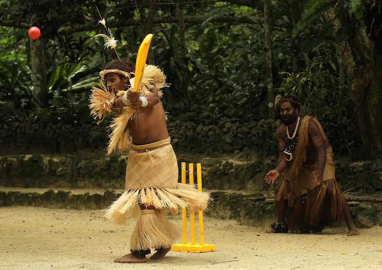 PORT VILA, VANUATU - MAY 16:  Locals in traditional dress play cricket during an ICC Cricket Development Program Clinic at Ekasup Cultural Village on May 16, 2012 in Port Vila, Vanuatu.  (Photo by Hamish Blair/Getty Images)