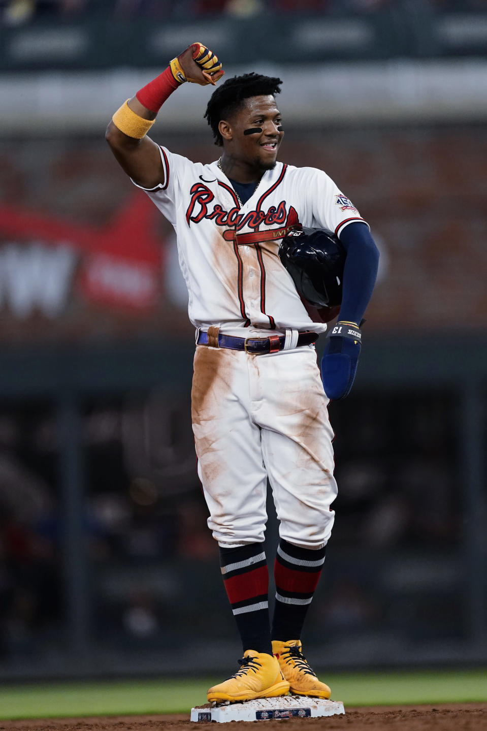 Atlanta Braves' Ronald Acuna Jr. reacts after a video review confirmed he was safe with a steal of second base in the sixth inning of the team's baseball game against the St. Louis Cardinals on Thursday, June 17, 2021, in Atlanta. (AP Photo/John Bazemore)