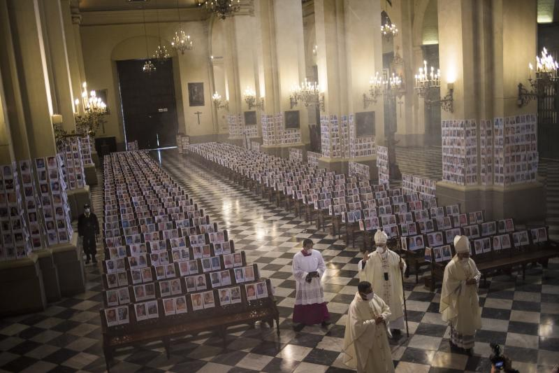 Portraits lined the pews and columns inside the Lima cathedral on Sunday. Source: AAP