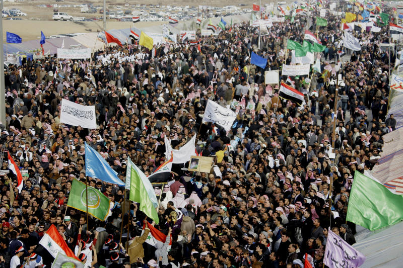 Protesters chant slogans against Iraq's Shiite-led government during a demonstration in Ramadi, 70 miles (115 kilometers) west of Baghdad, Iraq, Thursday, Jan. 24, 2013. Thousands of Iraqi Sunnis massed along a major western highway in a demonstration, intensifying pressure on the Shiite-led government. (AP Photo/ Khalid Mohammed)