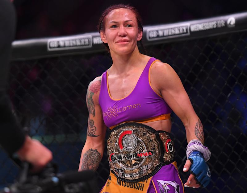 INGLEWOOD, CA - JANUARY 25: Cris Cyborg (blue gloves) in the cage after defeating Julia Budd (not pictured) in their featherweight world title fight at The Forum on January 25, 2020 in Inglewood, California. Cyborg won by TKO in the 4th round. (Photo by Jayne Kamin-Oncea/Getty Images)