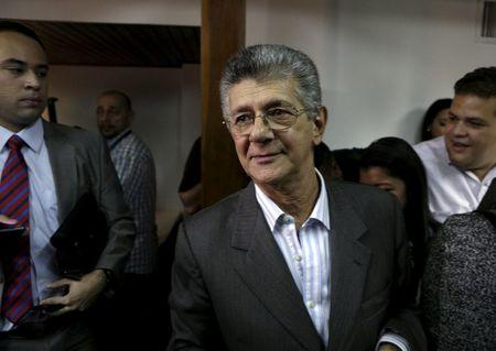 Deputy of Venezuela's coalition of opposition parties Ramos Allup walks after a news conference in Caracas