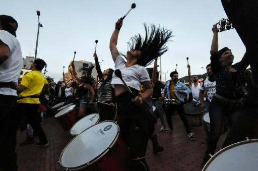 Hundreds of people, some playing musical instruments and others banging pots and pans, demonstrated on Thursday in the north of the capital Bogota