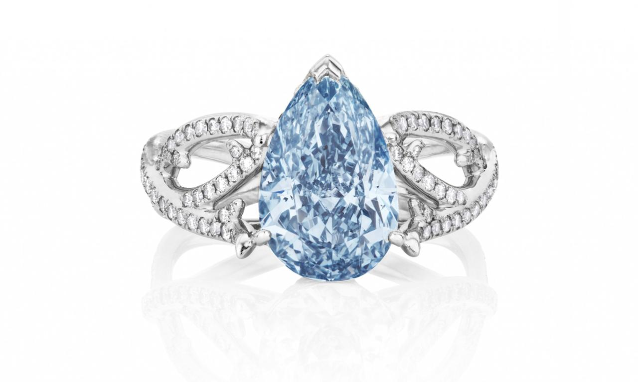 """<p>De Beers Volute Ring with Pear Cut Fancy Vivid Blue Diamond, price upon request, <a rel=""""nofollow"""" href=""""http://www.debeers.com/high-jewellery/bespoke-classics/1888-master-diamonds/volute-ring-with-pear-cut-fancy-vivid-blue-diamond"""">debeers.com</a> </p>"""