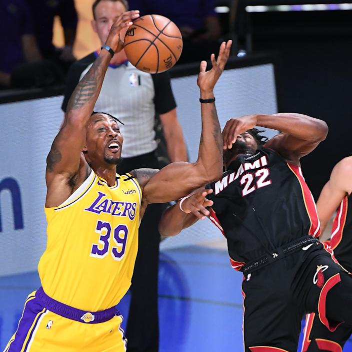 Lakers center Dwight Howard battles Heat forward Jimmy Butler for a rebound during Game 1.
