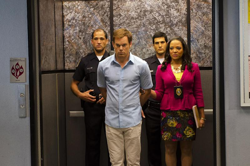 """This undated publicity photo released by Showtime shows Michael C. Hall, front left,  as Dexter Morgan and Lauren Velez as Maria LaGuerta in a scene from  """"Dexter,"""" Season 7, episode 12. The end is coming for """"Dexter,"""" Showtime's serial killer drama. The cable channel said Thursday, April 18, 2013, that the series' upcoming eighth season will be its last. (AP Photo/Showtime, Randy Tepper)"""