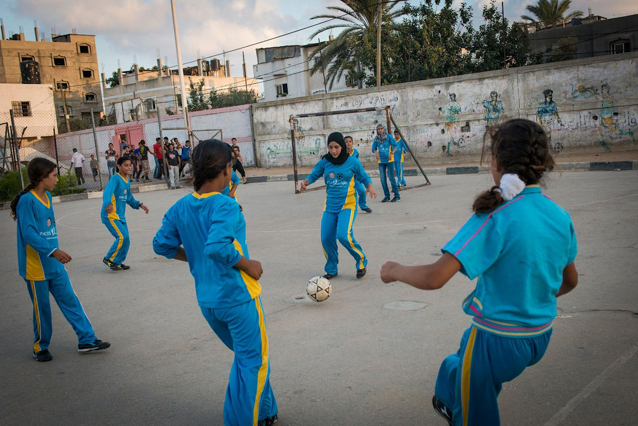 <p>Girls play football in the Northern Gaza town of Beit Lahiyah. Women in Gaza typically do all types of sports till the age of 16, when family pressure forces them to stop as many families seek to find husbands for them. (Photograph by Monique Jaques) </p>