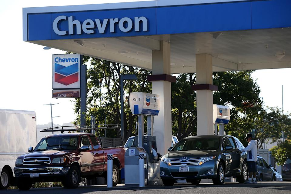 CORTE MADERA, CA - OCTOBER 30:  Customers get gasoline at a Chevron station on October 30, 2015 in Corte Madera, California. Chevron announced plans to cut up to 7,000 jobs as oil prices continue to slump. Chevron's third quarter revenue fell 37.2% to $34.3 billion compared to one year ago. (Photo by Justin Sullivan/Getty Images)
