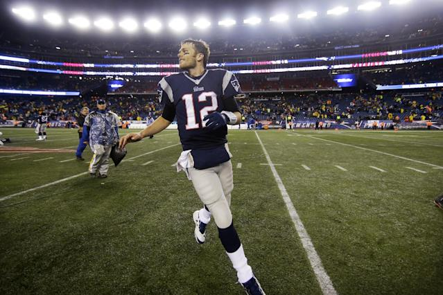 New England Patriots quarterback Tom Brady runs off the field after an AFC divisional NFL playoff football game against the Indianapolis Colts in Foxborough, Mass., Saturday, Jan. 11, 2014. The Patriots defeated the Colts 43-22 to advance the AFC Championship game. (AP Photo/Matt Slocum)