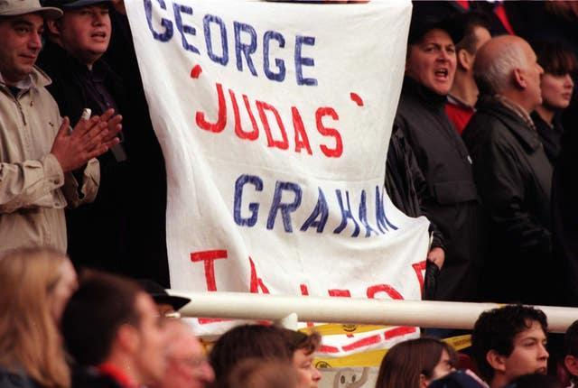 A banner displaying the words George 'Judas' Graham