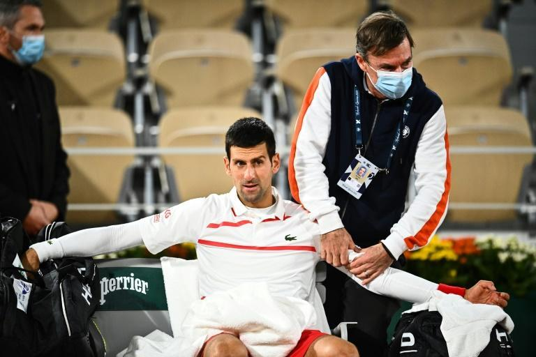 Feel the pain: Djokovic receives treatment on his arm and neck