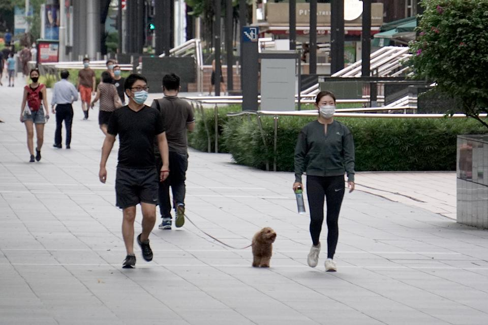 People in face masks seen along Orchard Road on 12 May 2020. (PHOTO: Dhany Osman / Yahoo News Singapore)