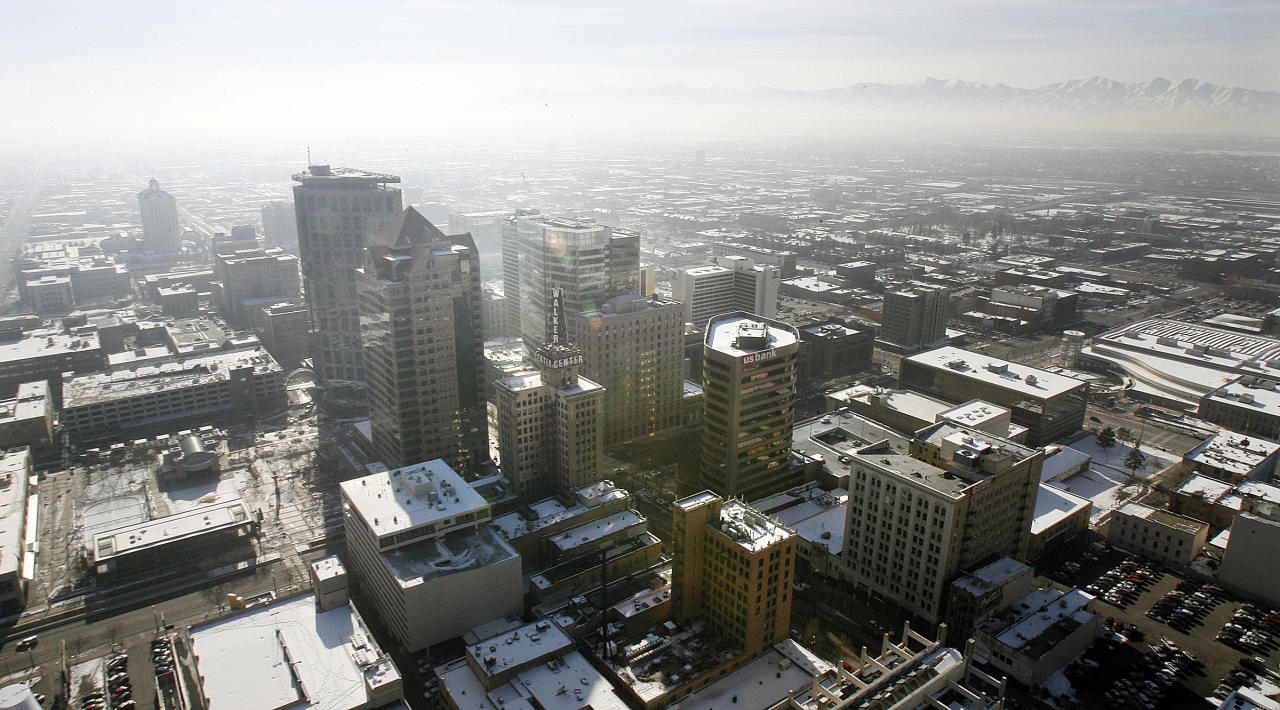 In this Jan. 9, 2013, photo, an inversion cloud covers downtown Salt Lake City. A group of Utah doctors is declaring a health emergency over the Salt Lake City area's lingering air pollution problem. Utah Physicians for a Healthy Environment planned to deliver a petition Wednesday, Jan. 23, 2013, demanding immediate action by elected officials. (AP Photo/The Deseret News, Ravell Cal)