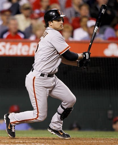 San Francisco Giants' Ryan Theriot watches his RBI-single against the Los Angeles Angels during the sixth inning of a baseball game in Anaheim, Calif., Monday, June 18, 2012. (AP Photo/Chris Carlson)