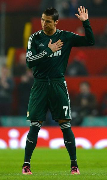 Friendly fire: Cristiano Ronaldo raises a hand in apology after scoring the winner for Real Madrid against Manchester United in the Champions League last 16 in 2013