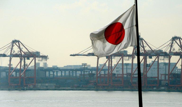 Japan's national flag is seen in front of the container pier of Tokyo port, on January 24, 2013