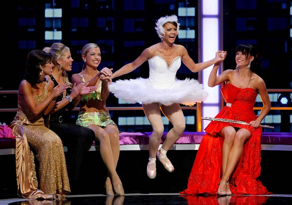 """Miss Jackie Geist (2nd R), Miss California, leaps in the air after being named a top 10 finalist as other contestants (L-R) Emily Ann Cox, Miss Kentucky, Olivia Myers, Miss Iowa, Ashlee Baracy, Miss Michigan, and Ashlen Batson, Miss Arkansas look on during the <a href=""""/miss-america-countdown-to-the-crown/show/44013"""">2009 Miss America Pageant</a> at the Planet Hollywood Resort & Casino January 24, 2009 in Las Vegas, Nevada."""