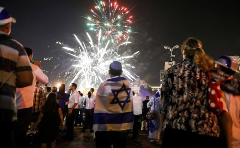 Israelis watch fireworks over Jerusalem on April 18, 2018, as they celebrate the 70th anniversary of the country's independence