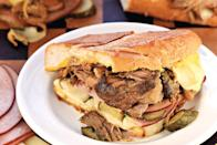 """Cuban pulled pork—or lechon asado—meets traditional Cuban ham and Swiss sandwiches in these zesty, melty paninis. <a href=""""https://www.epicurious.com/recipes/food/views/cuban-pulled-pork-paninis?mbid=synd_yahoo_rss"""" rel=""""nofollow noopener"""" target=""""_blank"""" data-ylk=""""slk:See recipe."""" class=""""link rapid-noclick-resp"""">See recipe.</a>"""
