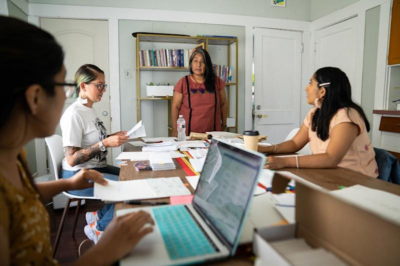 CIELO co-founder Odilia Romero leads a meeting in the organization's office.