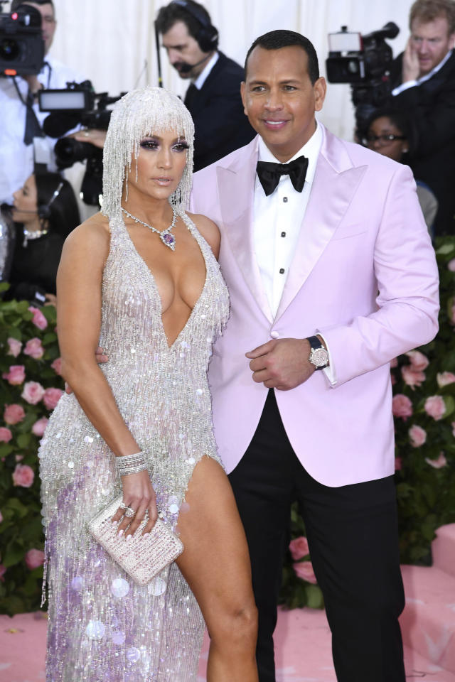 """April 22nd 2020 - Alex Rodriguez and Jennifer Lopez have reportedly retained JPMorgan Chase to raise capital for a possible bid for ownership of the New York Mets major league baseball team. - File Photo by: zz/Doug Peters/STAR MAX/IPx 2019 5/6/19 Jennifer Lopez and Alex Rodriguez at the 2019 Costume Institute Benefit Gala celebrating the opening of """"Camp: Notes on Fashion"""". (The Metropolitan Museum of Art, NYC)"""