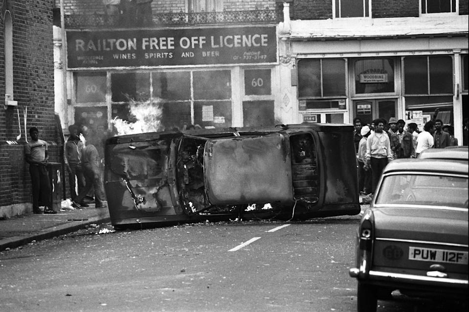 A car flipped over during the Brixton riots (BBC/Rogan Productions/Alamy Stock Photo)