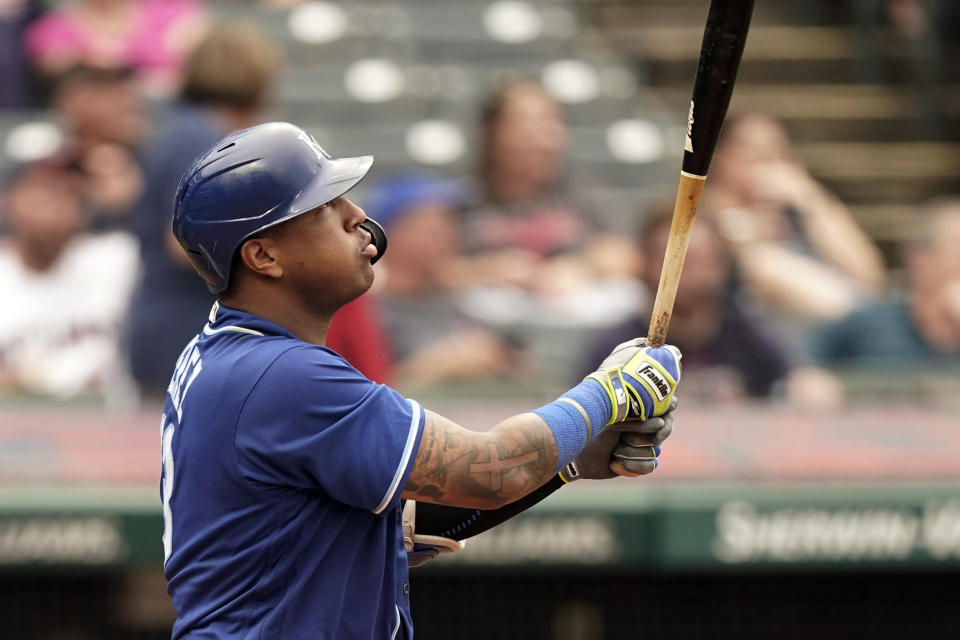 Kansas City Royals' Salvador Perez watches his two-run home run in the fifth inning in the first baseball game of a doubleheader against the Cleveland Indians, Monday, Sept. 20, 2021, in Cleveland. The home run broke Johnny Bench's record for the most home runs in a season by a primary catcher. (AP Photo/Tony Dejak)