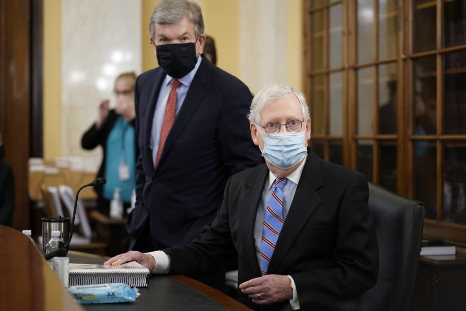 Senate Minority Leader Mitch McConnell of Ky., right, and Sen. Roy Blunt, R-Mo., prepare for a Senate Rules Committee hearing at the Capitol in Washington, Tuesday, May 11, 2021. (AP Photo/J. Scott Applewhite)