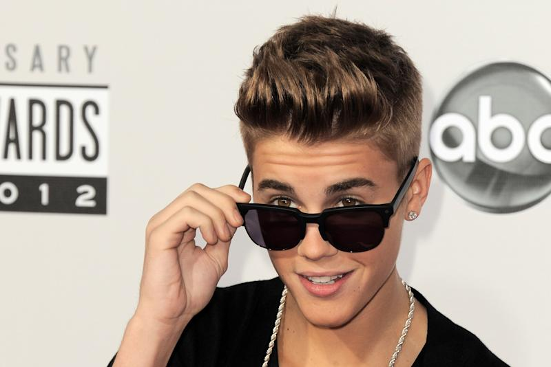 Justin Bieber arrives at the 40th Anniversary American Music Awards on Sunday, Nov. 18, 2012, in Los Angeles. (Photo by Jordan Strauss/Invision/AP)