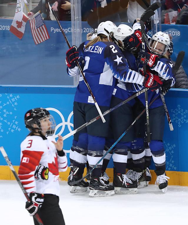 <p>American players celebrate scoring against Canada in the women's final ice hockey match as part of the 2018 Winter Olympic Games at the Gangneung Hockey Centre. Valery Sharifulin/TASS (Photo by Valery Sharifulin\TASS via Getty Images)the associated </p>
