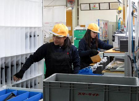 Filipina Gladys Gayeta, 22, a trainee at Starlite Co. car parts factory, works with her fellow trainee worker in Akitakata, Hiroshima prefecture, western Japan November 28, 2018. Picture taken November 28, 2018.  REUTERS/Linda Sieg
