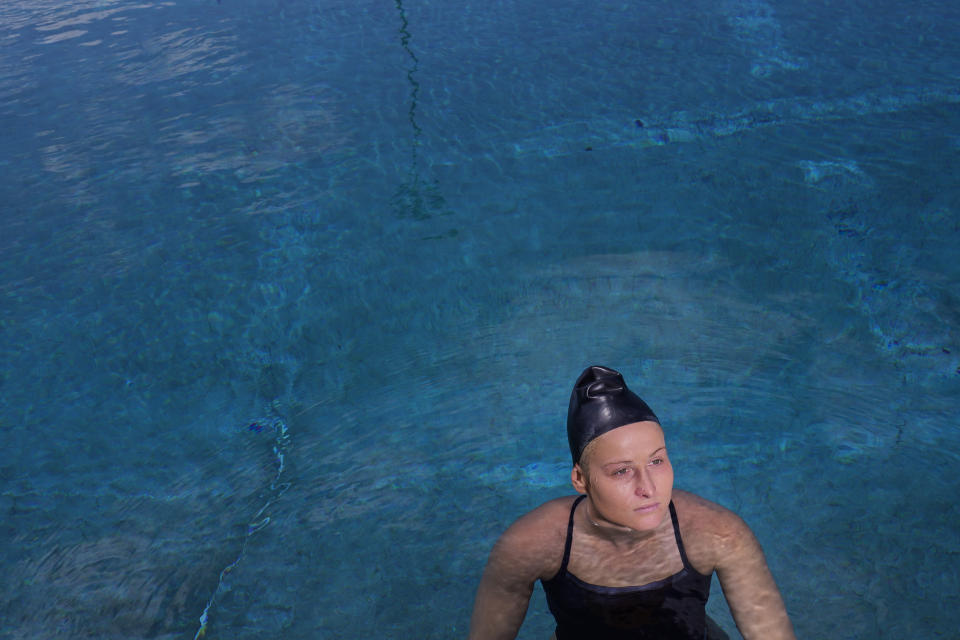 Stephania Haralabidis, a member of the U.S. women's water polo team, pauses for a photo at MWR Aquatic Training Center Tuesday, April 27, 2021, in Los Alamitos, Calif. Haralabidis, 26, is among five newcomers on the U.S. squad heading to the Tokyo Games this summer. The 13-player roster was announced Wednesday, June 23, 2021, in Los Angeles.(AP Photo/Jae C. Hong)