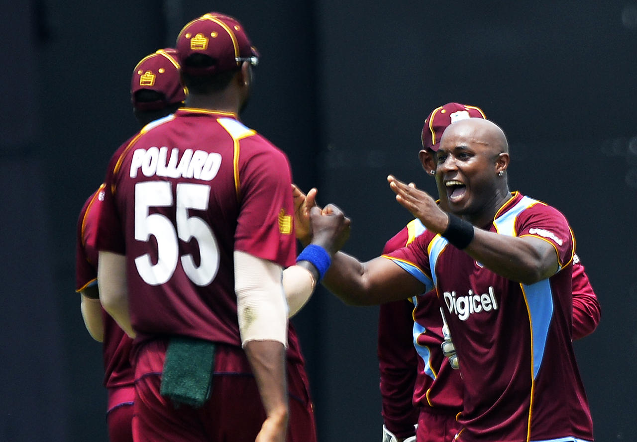 West Indies cricketer Tino Best (R) celebrates with teammates after dismissing Indian batsman Rohit Sharma during the fourth match of the Tri-Nation series between India and West Indies at the Queen's Park Oval in Port of Spain on July 5, 2013. West Indies won the toss and elected to field. AFP PHOTO/Jewel Samad        (Photo credit should read JEWEL SAMAD/AFP/Getty Images)