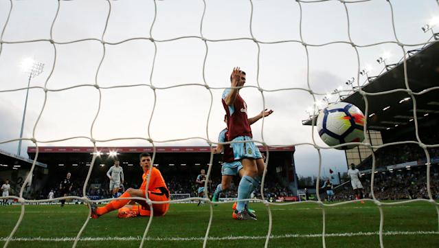 "Soccer Football - Premier League - Burnley vs Chelsea - Turf Moor, Burnley, Britain - April 19, 2018 Burnley's Kevin Long reacts after scoring an own goal and the first for Chelsea as Nick Pope looks on Action Images via Reuters/Andrew Boyers EDITORIAL USE ONLY. No use with unauthorized audio, video, data, fixture lists, club/league logos or ""live"" services. Online in-match use limited to 75 images, no video emulation. No use in betting, games or single club/league/player publications. Please contact your account representative for further details."